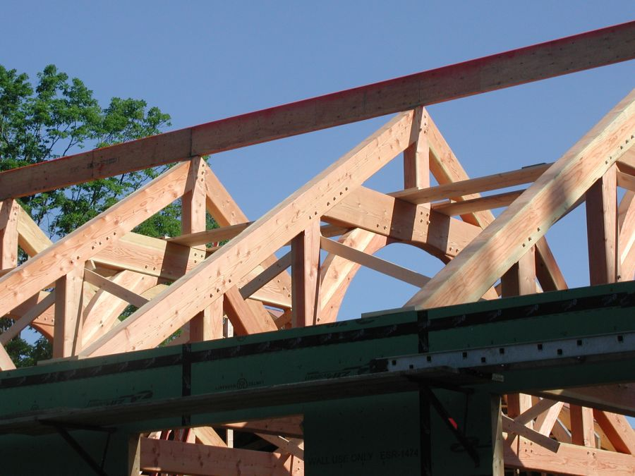 The type of truss varies depending on the structural needs of the particular building. This is a queenpost trust.