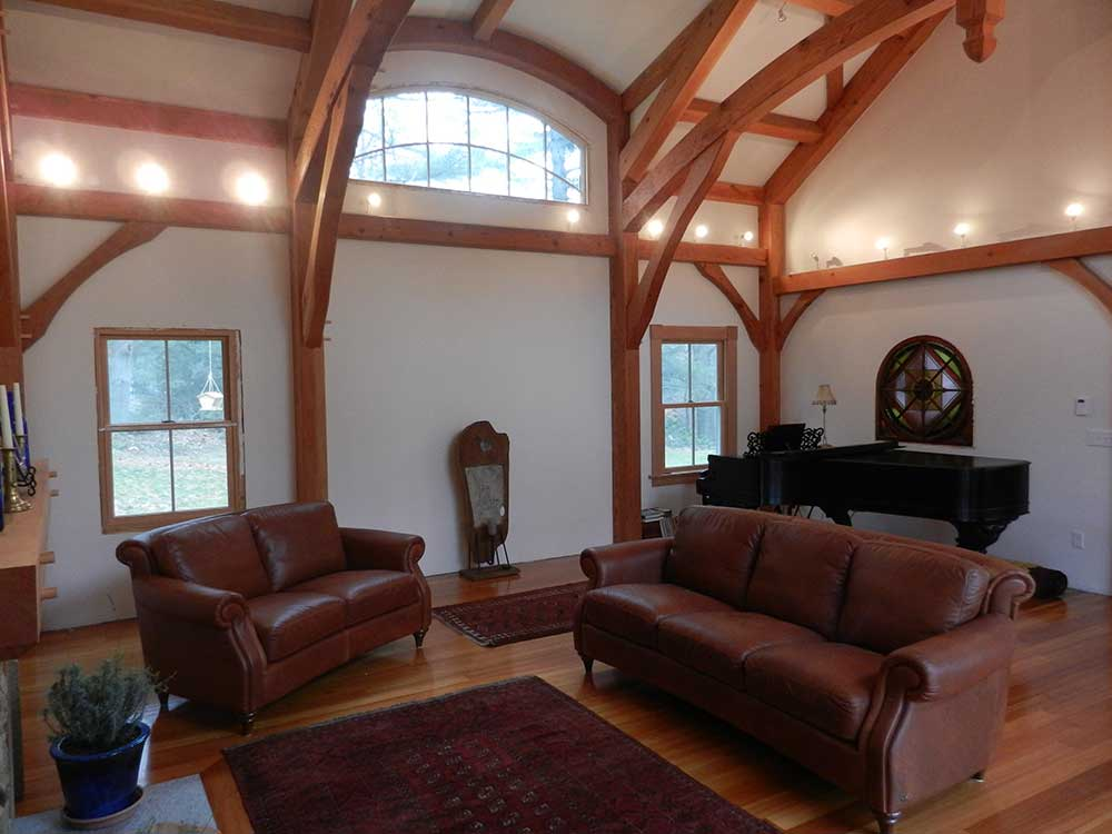 The decor is simple and uncluttered, highlighting the drama of the curved ceiling trusses.