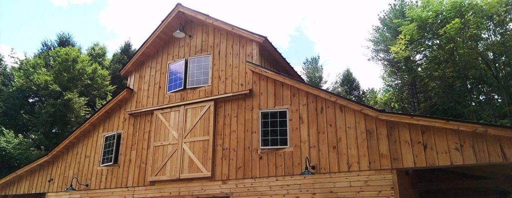 This handsome barn is multi-purpose and includes cleristory windows to bring light into the second floor.