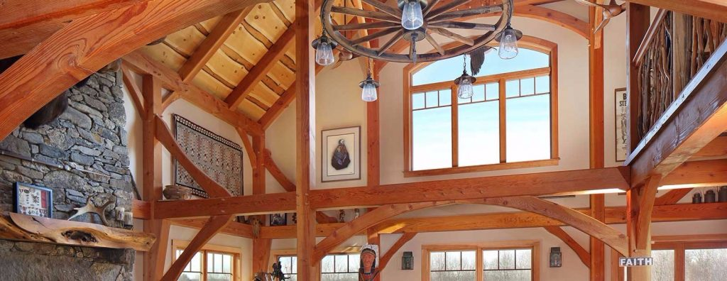 Timber frames work well in an open floor plan. The decor in this house evokes Western wide-open spaces.
