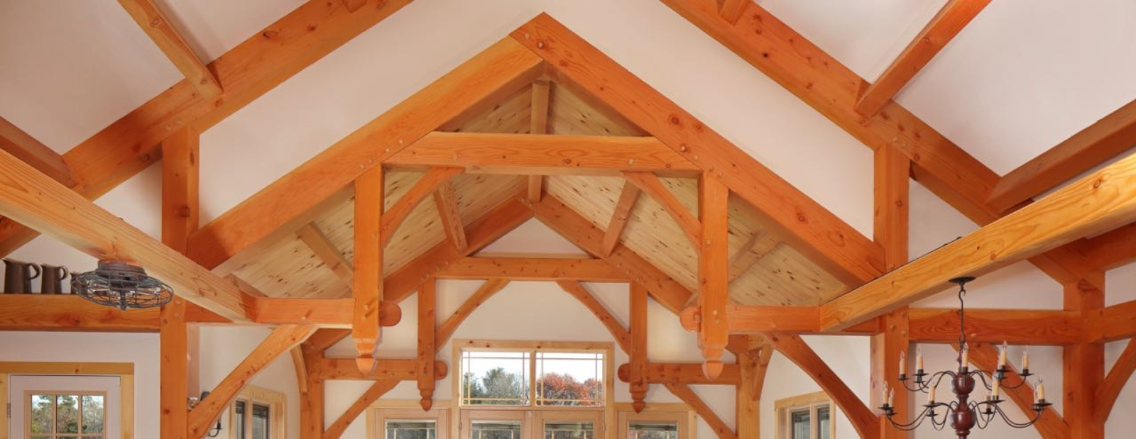 Timber frames with scissor trusses make a dramatic architectural statement.