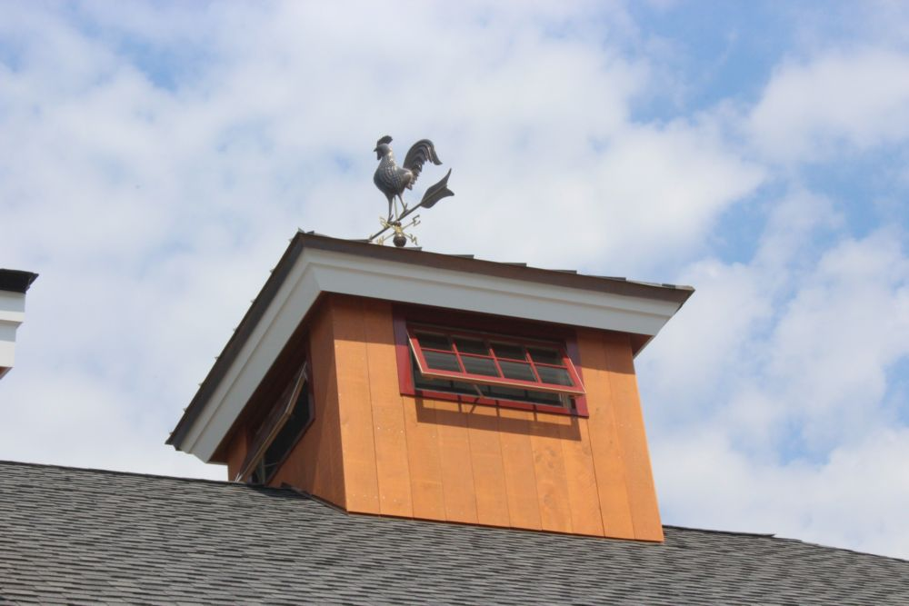 A cupola and weathervane add charm to the exterior of the building.