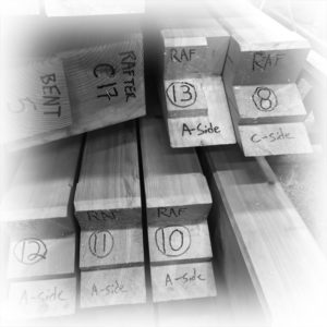 Each timber is labeled prior to assembling the frame. Raising the frame is one of the services that we offer.
