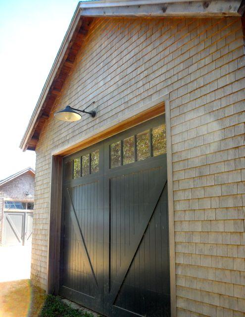Farm door on custom timber frame barn