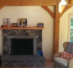 This fireplace evokes chilly evening, but the insulated timber frame offers year-round comfort and low maintenance.