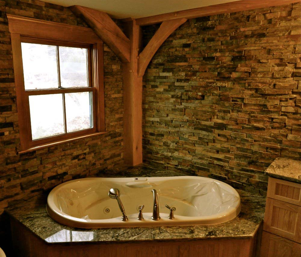 Stonewalled bathroom in custom timber frame home Lake Manchaug in Massachusetts