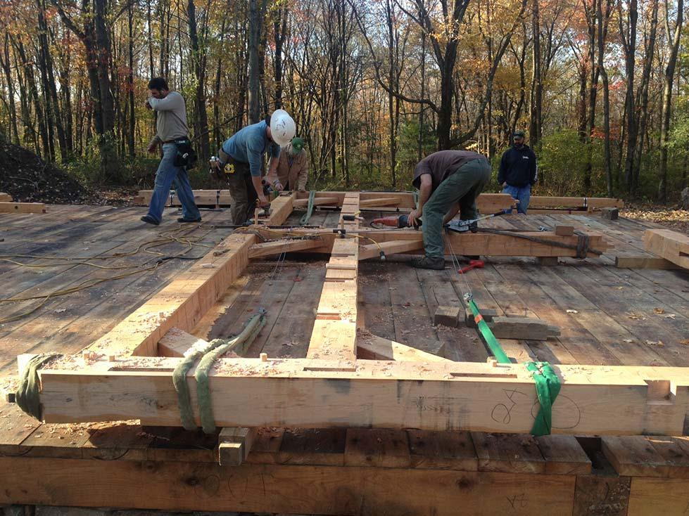 custom barn bent laying on deck in Massachusetts