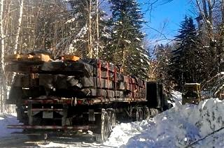 winter- tractor hauling trailer with timber frame