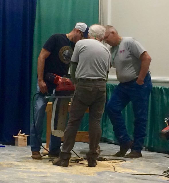 Checking out new tools at the Timber Framers Guild Conference.