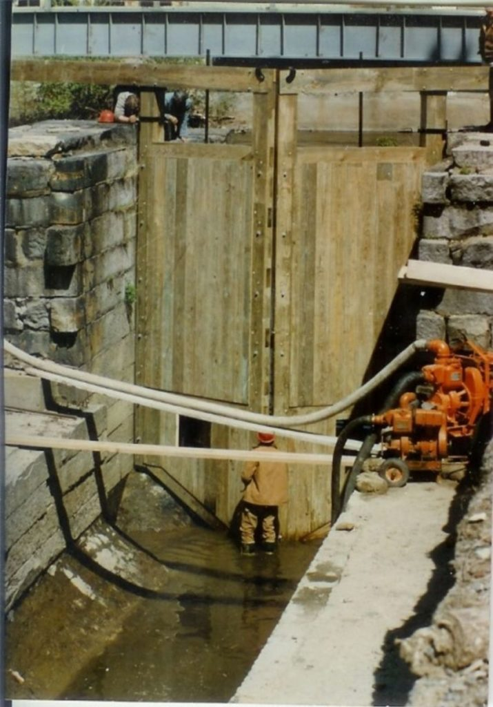 HP&B founder Ridge Shinn, stands in the lock chamber before the new gate, while pumps keep the water from filling the chamber.