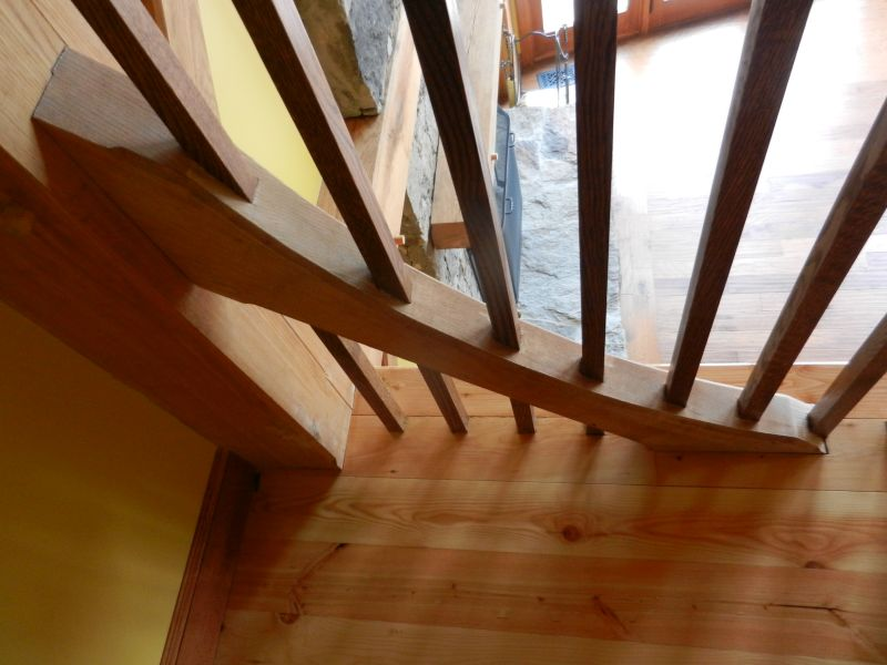 Stair rail posts in frame brace
